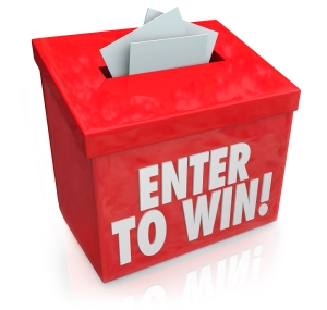 Enter To Win words on a red box with a slot for entering your tickets or entry form to win in a lottery, raffle or other game of chance